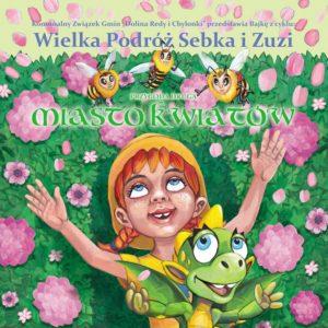 Kilkuletnia dziewczynka i mały zielony smok leżą na łące wśród kolorowych kwiatów.
